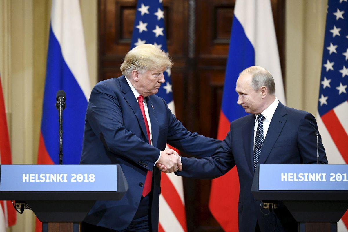 Trump i Putin donant-se la mà | Xinhua/Lehtikuva/Jussi Nukari via Getty